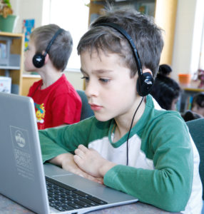 boy uses headset in class.